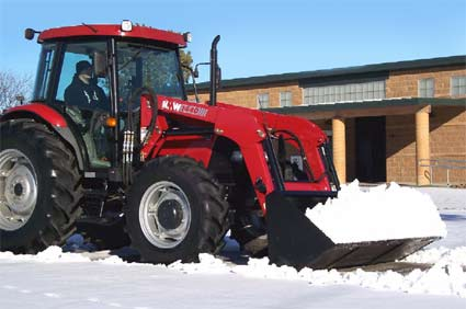 KMW 1440 Tractor removing snow.